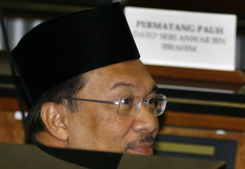 Malaysia opposition leader Anwar Ibrahim gestures during a swearing in ceremony at Parliament House in Kuala Lumpur on August 28, 2008. Anwar Ibrahim will return to parliment after a ten year absence after winning a hotly contested by-election in northern Penang state tthat now will make him the parliamentary Leader of The Opposition. Anwar claimed a landslide victory this week in a by-election to return him to parliament, capping a stunning comeback after he was sacked as deputy premier in 1998 and jailed for sodomy and corruption.
