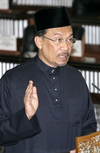 Malaysian opposition leader Anwar Ibrahim swears in at Parliament house in Kuala Lumpur, Malaysia, Thursday, Aug. 28, 2008. Anwar took his place Thursday as a member of Malaysia's Parliament, a major step in his goal to topple the government weakened by electoral defeats and internal dissent.