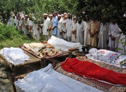 Pakistani men attend to the funeral of members of a family killed by a mortar shell in the village of Deolai in Pakistan's Swat valley,Thursday, July 31, 2008. A mortar shell hit a house in a northern valley where Pakistani security forces are battling Islamic fighters, killing a family of seven, police said Thursday.AP Photo