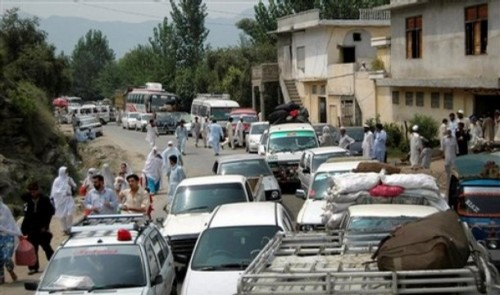 People flee from the troubled area of the Swat valley in northern Pakistan Thursday, July 31, 2008. A mortar shell hit a house in the valley where Pakistani security forces are battling Islamic fighters, killing a family of seven, police said Thursday.AP Photo