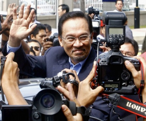 Malaysian opposition leader Anwar Ibrahim waves to his supporters outside the Sessions Court in Kuala Lumpur on September 10, 2008. Anwar was in court to face a sodomy charge similar to one filed against him a decade ago and which he claim as politically motivated. The case was postpone until September 24.      AFP PHOTO / KAMARUL AKHIR (Photo credit should read KAMARUL AKHIR/AFP/Getty Images)