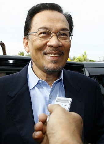 Malaysian opposition leader Anwar Ibrahim smiles as he arrives at the court house in Kuala Lumpur on September 10, 2008. Anwar was in court to face a sodomy charge similar to one filed against him a decade ago and which he claim as politically motivated. The case was postponed until September 24.