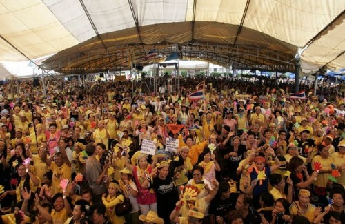 Supporters of the People's Alliance for Democracy (PAD) cerebrate at the Government House in Bangkok on October 21, 2008. Thailand's Supreme Court ruled on Tuesday that former prime minister Thaksin Shinawatra had violated a conflict-of-interest law while in office and sentenced him to two years in prison.