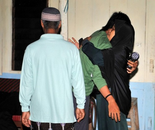 CAPTION ADDITION -- The son (C) of the convicted 2002 Bali bomber Amrozi, Mahendra is comforted by relative at Al Islam boarding school in Tenggulun in the early morning of November 9, 2008 as they hear news that the three Bali bombers have been executed. Three Islamists sentenced to death for the Bali bombings which killed 202 people were executed by firing squad at midnight, local television reported. Amrozi, 47, his brother Mukhlas, 48, and ringleader Imam Samudra, 38, were killed with shots to the heart on the island prison of Nusakambangan off southern Java, TV One television reported quoting an official source. AFP PHOTO/ADEK BERRY (Photo credit should read ADEK BERRY/AFP/Getty Images)