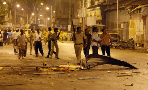 Indian policeman prepare to take position at the site of attack in Colaba area of Mumbai on November 27, 2008. Nearly 80 people were killed in a series of shootings and blasts across India's financial capital Mumbai late 26 November, the state government said. The Maharashtra state government said the death toll had risen to 78, according to the Press Trust of India news agency, and that six Indian army units had been deployed to the south of the city. Heavily armed men with automatic weapons and grenades targeted two of Mumbai's top luxury hotels, the Taj Mahal and Trident, and the main Chhatrapati Shivaji railway station. AFP PHOTO/Indranil MUKHERJEE (Photo credit should read INDRANIL MUKHERJEE/AFP/Getty Images)