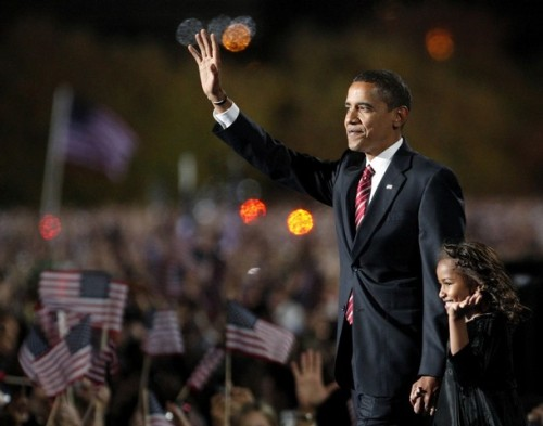 U.S. President-elect Senator Barack Obama (D-IL) waves with his daughter Sasha as he comes onto stage holding her hand to speak to supporters during his election night rally after being declared the winner of the 2008 U.S. Presidential Campaign in Chicago, November 4, 2008.