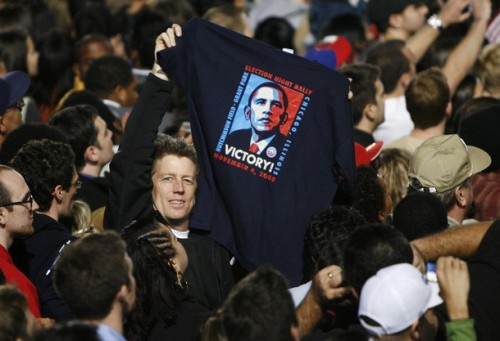 A supporter of U.S. President-elect Senator Barack Obama (D-IL) holds up an Obama t-shirt during his election night rally in Chicago November 4, 2008. Obama captured the White House on Tuesday after an extraordinary two-year campaign, defeating Republican John McCain to make history as the first black to be elected U.S. president.