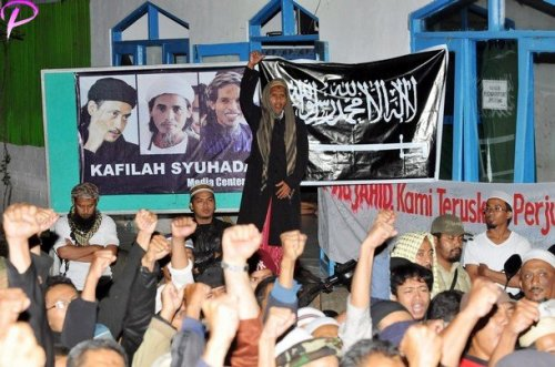 "Brother of the two convicted 2002 Bali bombers Amrozi and Mukhlas, Jafar Shodiq (C, standing) shouts ""God is great"" along with supporters, at Al Islam boarding school in Tenggulun in the early morning of November 9, 2008 as they hear news that the three Bali bombers have been executed. Three Islamists sentenced to death for the Bali bombings which killed 202 people were executed by firing squad at midnight, local television reported. Amrozi, 47, his brother Mukhlas, 48, and ringleader Imam Samudra, 38, were killed with shots to the heart on the island prison of Nusakambangan off southern Java, TV One television reported quoting an official source."