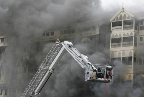 Firefighters douse a blaze at Taj Mahal Hotel in Mumbai November 29, 2008. Operations to dislodge militants at the Taj Mahal hotel in Mumbai ended on Saturday, security officials said, and at least three Islamist gunmen were killed.