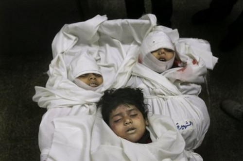 Three Palestinian children from the Balosha family, of five who were all killed in the same Israeli missile strike,  are seen in the morgue before their burial at Kamal Edwan hopsital in Beit Lahiya, northern Gaza Strip, Monday, Dec. 29, 2008. Israel's overwhelming air campaign against the Gaza Strip inched closer to the territory's Hamas rulers as the assault entered its third day Monday, as missiles struck a house next to the Hamas premier's home and destroyed symbols of the Islamic movement's power. (AP Photo/Eyad Baba)