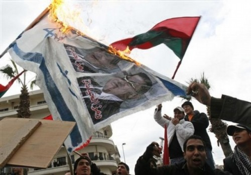 """"""" the symbol of treachery,"""" in the southern port city of Sidon, Lebanon, Monday, Dec. 29, 2008. Around 3,000 people staged a demonstration to protest Israel's air assault on the Gaza Strip, now into its third day. (AP Photo/Mohammed Zaatari)"""