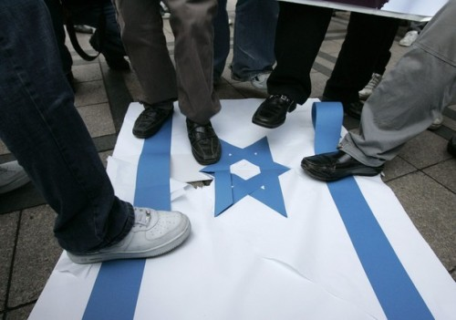 South Korean protesters step on an Israeli flag during a pro-Palestinian rally denouncing Israel's attacks on Gaza in front of the Israeli embassy in Seoul December 30, 2008.  REUTERS/Jo Yong-Hak (SOUTH KOREA)