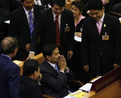 Abhisit Vejjajiva (c) greets members of Parliament after being voted in as the prime minister of Thailand in Bangkok December 15 2008. Thailand's opposition Democrat Party leader, Vejjajiva, won a thin majority in a parliamentary vote on Monday to become the country's third prime minister in as many months.  REUTERS/Sukree Sukplang   (THAILAND)