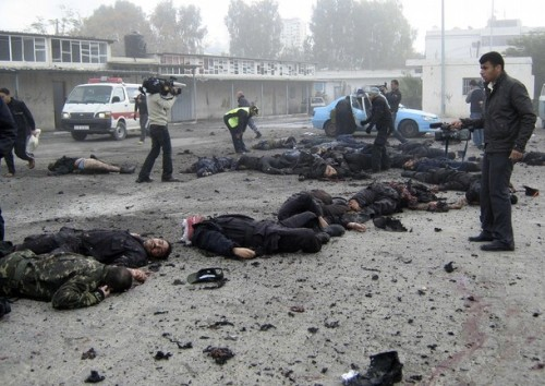 Bodies of Hamas policemen lie on the ground of their destroyed police compound following an Israeli air strike in Gaza December 27, 2008. Israeli air strikes in the Hamas-ruled Gaza Strip on Saturday killed at least 195 Palestinians, health officials in Gaza said. REUTERS/Zoher Dolah (GAZA)