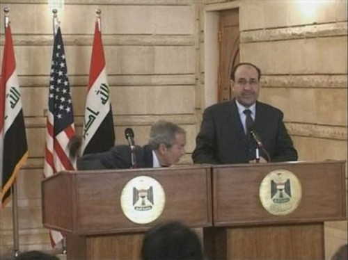 In this image from APTN video, US President George W. Bush, left, ducks as a man throws a shoe at him, during a news conference with Iraq Prime Minister Nouri al-Maliki, Sunday, Dec. 14, 2008, in Baghdad, Iraq. On an Iraq trip shrouded in secrecy and marred by dissent, President George W. Bush on Sunday hailed progress in the war that defines his presidency and got a size-10 reminder of his unpopularity when a man hurled two shoes at him during a news conference. (AP Photo)