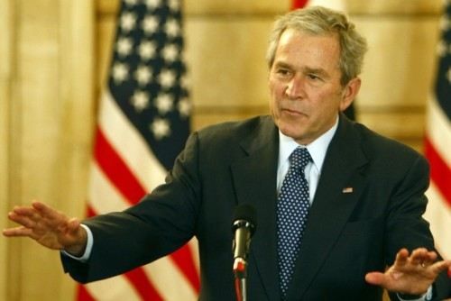 U.S. President George W. Bush reacts to calm down after a shoe was thrown at him by an Iraqi reporter during a joint press conference with Iraqi Prime Minister Nuri al-Maliki (unseen) in Baghdad December 14, 2008. President George W. Bush made an unannounced farewell visit to Baghdad today, just weeks before he leaves his office to President-elect Barack Obama.  AFP PHOTO/ Thaier al-Sudani -POOL (Photo credit should read THAIER AL-SUDANI/AFP/Getty Images)