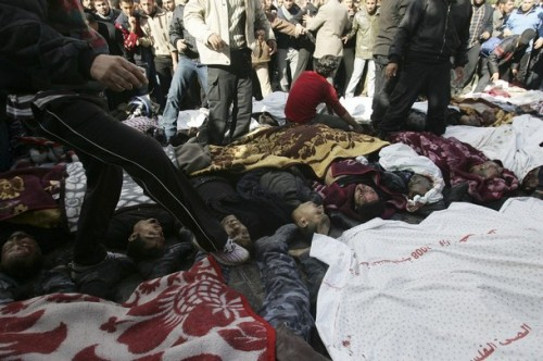 THIS IMAGE CONTAINS GRAPHIC CONTENT) Bodies of Palestinians are laid out on the ground outside Shifa hospital on December 27, 2008 in Gaza City, Gaza.Israel's air force fired about 30 missiles at targets along the Gaza Strip on Saturday, destroying several Hamas police compounds, killing more than 200 people and wounding hundreds. (Photo by Abid Katib/Getty Images)