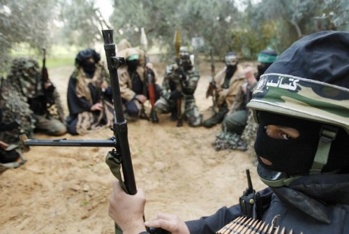 Hamas militants receive instructions after a training drill near the border with the Gaza Strip December 19, 2008. Hamas on Thursday declared an end to a six-month-old Egyptian-brokered ceasefire with Israel in the Gaza Strip, raising the prospect of an escalation in cross-border fighting. REUTERS