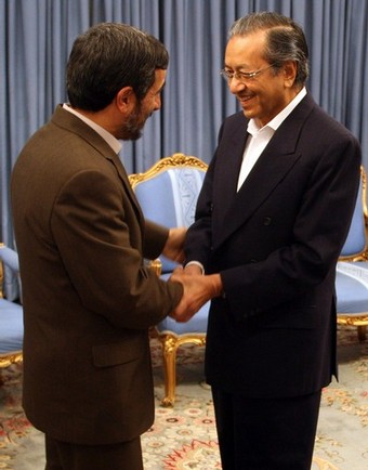 Iranian President Mahmoud Ahmadinejad shakes hands with the former prime minister of Malaysia, Mahatir Mohammad (R), in Tehran on December 1, 2008. Mohammad is on an official visit to the Islamic republic. AFP PHOTO/ATTA KENARE (Photo credit should read ATTA KENARE/AFP/Getty Images)