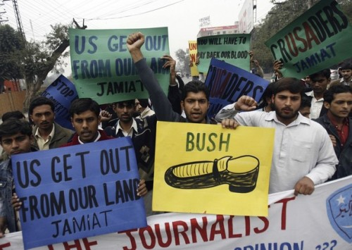 Activists of Jamaat-e-Islami political party, Pakistan's best-organised Islamic party, hold placards in support of Iraqi journalist Muntazer al-Zaidi, who threw his shoes at U.S. President George W. Bush in Baghdad on December 14, during a rally in Lahore December 18, 2008.   REUTERS/Mohsin Raza    (PAKISTAN)