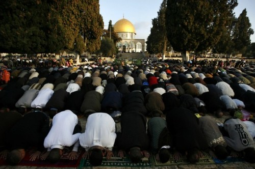 Palestinian Muslims pray at Jerusalem's Al-Aqsa mosque compound on December 8, 2008, to pray on the first day of the Muslim feast day Eid al-Adha. Eid al-Adha, the Festival of Sacrifice, is celebrated by Muslims around the world by slaughtering camels, goats, sheeps and cattle in commemoration of the prophet Abraham's readiness to sacrifice his son to show obedience to God.