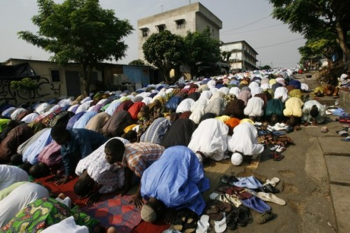 Muslims pray along a street in Attiecoube in Abidjan December 8, 2008. Muslims around the world celebrate Eid al-Adha by slaughtering sheep, goats, camels and cows to commemorate Prophet Abraham's willingness to sacrifice his son, Ismail, on God's command.   REUTERS