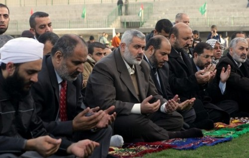 Hamas leader Ismail Haniya (C) attends a special prayer organized by Hamas on the first day of Eid al-Adha in Gaza City on December 8, 2008. Eid al-Adha, the Festival of Sacrifice, is celebrated by Muslims around the world by slaughtering camels, goats, sheeps and cattle in commemoration of the prophet Abraham's readiness to sacrifice his son to show obedience to God.