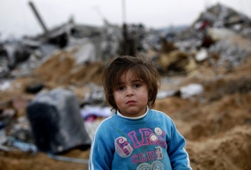 A Palestinian girl stands amongst the ruins of destroyed houses on the outskirts of Jabalya in the northern Gaza Strip January 19, 2009. More Israeli forces left the Gaza Strip on Monday after a 22-day assault on Hamas militants, and both sides kept a ceasefire, allowing dazed Palestinians to survey the destruction and mourn their dead. REUTERS/Jerry Lampen (GAZA)