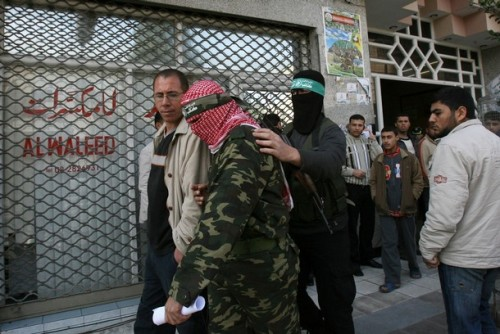 Two members of the Ezzedine Al-Qassam brigades, Hamas's military wing, leave after giving a press conference in Gaza City on January 19, 2009. Hamas's armed wing said today that it lost only 48 fighters during Israel's 22-day operation in Gaza. Israel has said that it killed more than 500 Hamas members during Operation Cast Lead that it launched on Gaza on December 27 and which it ended on Sunday with a unilateral ceasefire.  AFP PHOTO / MOHAMMED ABED (Photo credit should read MOHAMMED ABED/AFP/Getty Images)