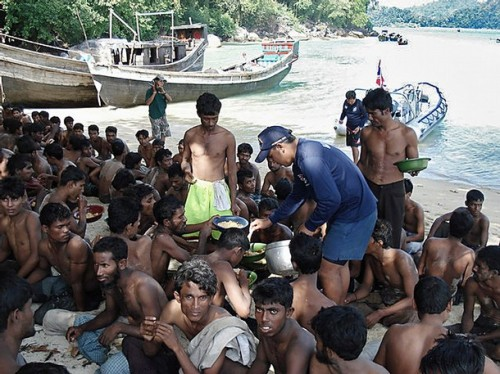 This undated handout photo released by Thai Royal Navy on January 20, 2009 shows illegal immigrants from Bangladesh and Myanmar receiving food on the beach after they were escorted by Thai navy to Similan island south of Thailand.  Thailand's army chief said January 20, 2009 that the military followed humanitarian principles when dealing with boat people from Myanmar whom they stand accused of mistreating, a security spokesman said. Survivors and a human rights group have accused the Thai army and navy of detaining and beating up to 1,000 members of a Rohingya minority from Myanmar late last year, before towing them out to sea with little food and water. AFP PHOTO/Thai Royal Navy/HO  RESTRICTED TO EDITORIAL USE (Photo credit should read AFP/AFP/Getty Images)
