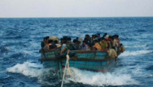 Rohingya migrants are seen in a boat being pulled out to sea off of Koh Sai Daeng in southwest Thailand in this undated photo obtained by CNN. Pressure mounted on Thailand on January 26, 2009 to come clean on allegations the army towed Rohingya refugees out to sea and abandoned them in engine-less boats, after CNN showed pictures depicting exactly that.  REUTERS/CNN  (THAILAND)  MANDATORY CREDIT.  NO SALES. NO ARCHIVES. FOR EDITORIAL USE ONLY. NOT FOR SALE FOR MARKETING OR ADVERTISING CAMPAIGNS.