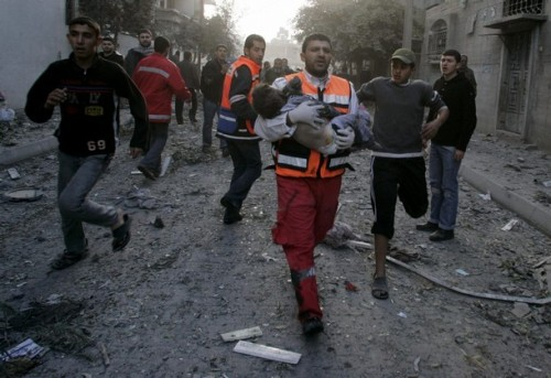 A Palestinian medic carries a wounded boy after an Israeli air strike on the home of senior Hamas leader Nizar Rayan in Gaza January 1, 2009. Israel killed the senior Hamas leader in an air attack on his home on Thursday, striking its first deadly blow against the top ranks of the Islamist group in a Gaza offensive that has claimed more than 400 Palestinian lives. REUTERS/Ismail Zaydah (GAZA)