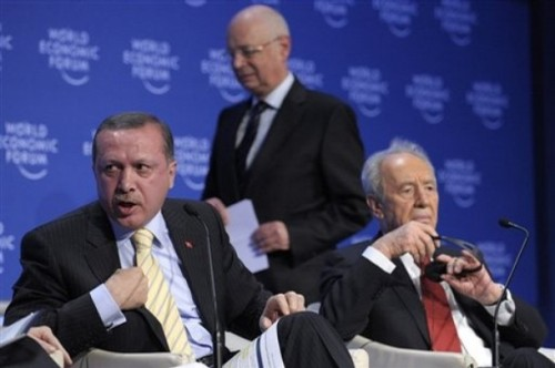 Recep Tayyip Erdogan, Prime Minister of Turkey, left, just before he leaves the stage in front of Shimon Peres, right, President of Israel and Swiss Klaus Schwab, founder and president of the World Economic Forum, WEF, during a plenary session on the Middle East Peace at the Annual Meeting of the World Economic Forum, WEF, in Davos, Switzerland, Thursday, Jan. 29, 2009. Turkish President Recep Tayyip Erdogan has later stalked off the stage at the World Economic Forum,  after verbally sparring over Gaza with Israeli President Shimon Peres.  (AP Photo/Keystone/Laurent Gillieron)