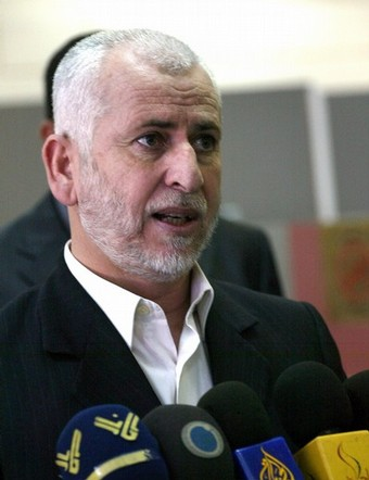 Palestinian former interior minister Said Siam speaks to the press at the Rafah border terminal crossing between the southern Gaza Strip and Egypt on July 8, 2008. A Hamas delegation is due in Cairo for talks on a fragile three-week-old Gaza truce as Israel said it would reopen its borders with the territory at the Egyptian mediator's request. AFP PHOTO/ SAID KHATIB (Photo credit should read SAID KHATIB/AFP/Getty Images)