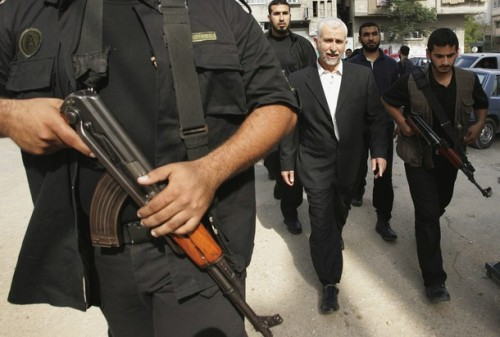 Palestinian Interior Minister Saeed Seyyam (2nd R) walks surrounded by his bodyguards after Friday prayers in Gaza in this October 27, 2006 file picture. An Israeli air strike killed Hamas's interior minister, Saeed Seyyam, in the Gaza Strip on Thursday, Hamas-run television said. Seyyam had been in charge of 13,000 Hamas police and security men, many of whom are actively involved in fighting Israel.  REUTERS/Mohammed Salem/Files (GAZA)