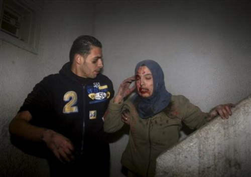 A wounded Palestinian woman is evacuated after an Israeli strike hit the house of top Hamas official Said Siam's brother in Gaza City, Thursday, Jan. 15, 2009. Officials from the Israeli military and Shin Bet security agency said Siam was killed while hiding in his brother's home in Gaza City. Siam is considered to be among Hamas' top five leaders in Gaza.  Palestinian medical officials confirmed the house was attacked, but there was no word from Hamas on Siam's fate. (AP Photo/Khalil Hamra)