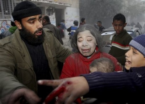 A wounded Palestinian girl is evacuated after an Israeli strike hit the house of top Hamas official Said Siam's brother in Gaza City, Thursday, Jan. 15, 2009. Officials from the Israeli military and Shin Bet security agency said Siam was killed while hiding in his brother's home in Gaza City. Siam is considered to be among Hamas' top five leaders in Gaza.  Palestinian medical officials confirmed the house was attacked, but there was no word from Hamas on Siam's fate. (AP Photo/Khalil Hamra)