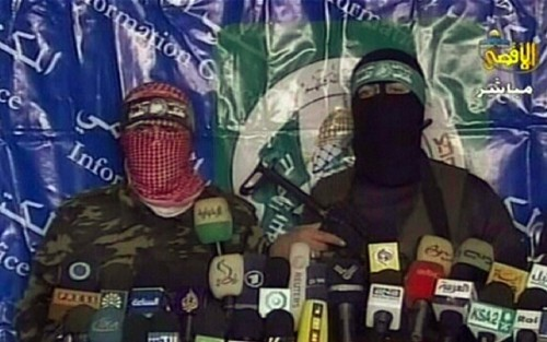 An image grab taken from the Hamas Islamist movement television channel Al-Aqsa TV on January 19, 2009, shows two members of the Ezzedine Al-Qassam brigades, Hamas's military wing, giving a televised press conference at a location in the Gaza Strip. Hamas's armed wing said today that it lost only 48 fighters during Israel's 22-day operation in Gaza. Israel has said that it killed more than 500 Hamas members during Operation Cast Lead that it launched on Gaza on December 27 and which it ended on Sunday with a unilateral ceasefire. AFP PHOTO/HO/AL-AQSA TV ++ RESTRICTED TO EDITORIAL USE ++ (Photo credit should read -/AFP/Getty Images)