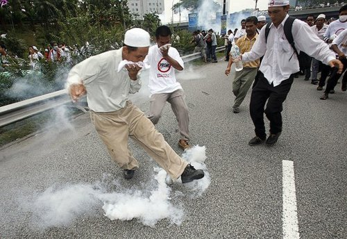 A protester kicks a tear gas canister during a demonstration against the use of the English language in teaching science and mathematics at schools, in Kuala Lumpur March 7, 2009. Malaysian police fired tear gas to disperse hundreds of opposition activists demanding that science and math be taught in the national Malay language, witnesses said. Language is a sensitive issue for the country's majority Malays and represents the latest political battleground for incoming Prime Minister Najib Razak, who is already facing a challenge from a weakening economy.    REUTERS PICTURES