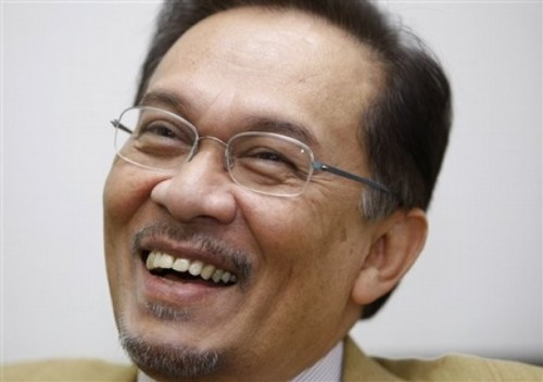 Malaysian opposition leader Anwar Ibrahim smiles during an interview at his office in Parliament building in Kuala Lumpur, Malaysia, June 25, 2009. Anwar said he is prepared to be jailed for sodomy in a trial next month, but warned his conviction would unleash a groundswell of public support that would rout the government in the next elections.