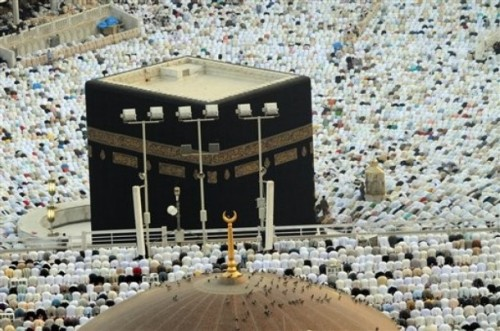 Muslim worshippers circle the Kaaba as they perform the early morning Eid al-Fitr prayer at the Grand Mosque in Mecca, Saudi Arabia, Sunday, Sept. 20, 2009. Al-Fitr festival marks the end of the Muslim fasting month of Ramadan. (AP Photo/Issa Mohammad)
