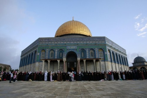 "Palestinian and other Muslim worshippers perform the Eid al-Fitr prayer at the Dome of the Rock mosque in Jerusalem's Al-Aqsa compound to mark the end of the holy month of Ramadan on September 20, 2009. Al-Aqsa is Islam's third holiest shrine after Mecca and Medina in Saudi Arabia. In Iran, the Islamic republic's supreme leader Ayatollah Ali Khamenei blasted Israel in his Eid sermon, saying the ""Zionist cancer"" was gnawing into the lives of Islamic nations. AFP PHOTO/AHMAD GHARABLI (Photo credit should read AHMAD GHARABLI/AFP/Getty Images)"